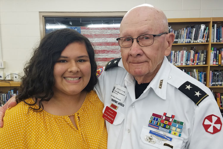 Jade thanks the General for his service and asks to have her picture taken with him.